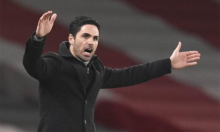 Arteta cho rằng Arsenal trả giá bằng thất bại vì nhập cuộc không tốt trước Man City. Ảnh: Reuters.