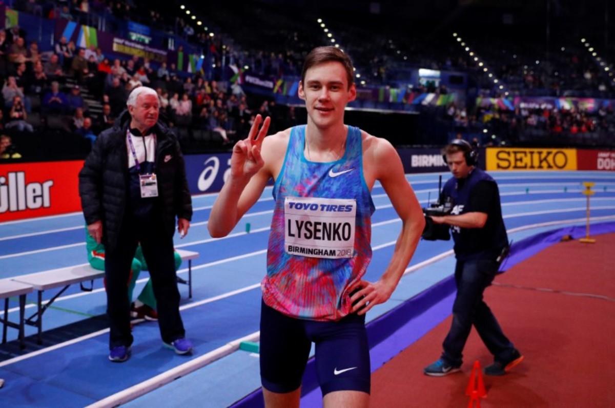 Lysenko vui mừng sua khi đoạt HC vàng nhảy cao tại giải vô địch thế giới điền kinh trong nhà 2018, tại Birmingham, Anh. Ảnh: Reuters