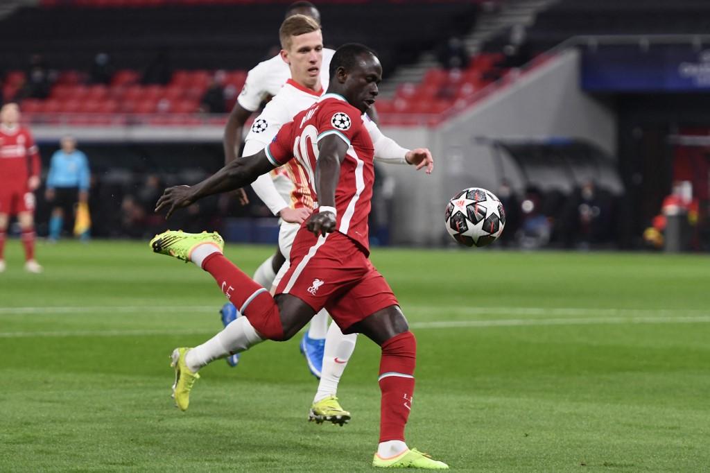 Sadio Mane mencetak gol saat Liverpool mengalahkan RB Leipzig 2-0 di leg kedua babak 1/8 Liga Champions pada 10 Maret.  Foto: AFP