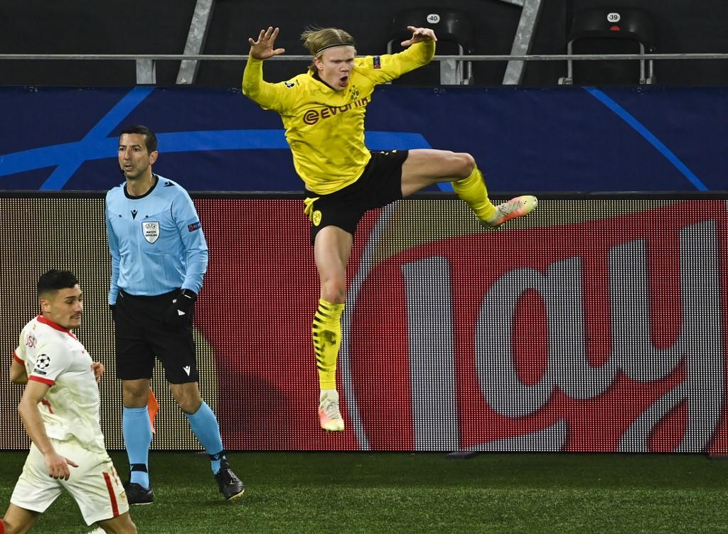 ฮาลันด์มีความสุขเมื่อเขายิงสองครั้งกับเซบีย่าในเลกที่สองของรอบ 1/8 แชมเปียนส์ลีกเมื่อวันที่ 9 มีนาคม  ภาพ: AFP