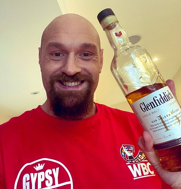 Fury showed off pictures of drinking beer and alcohol during a month off training.  Photo: Twitter.