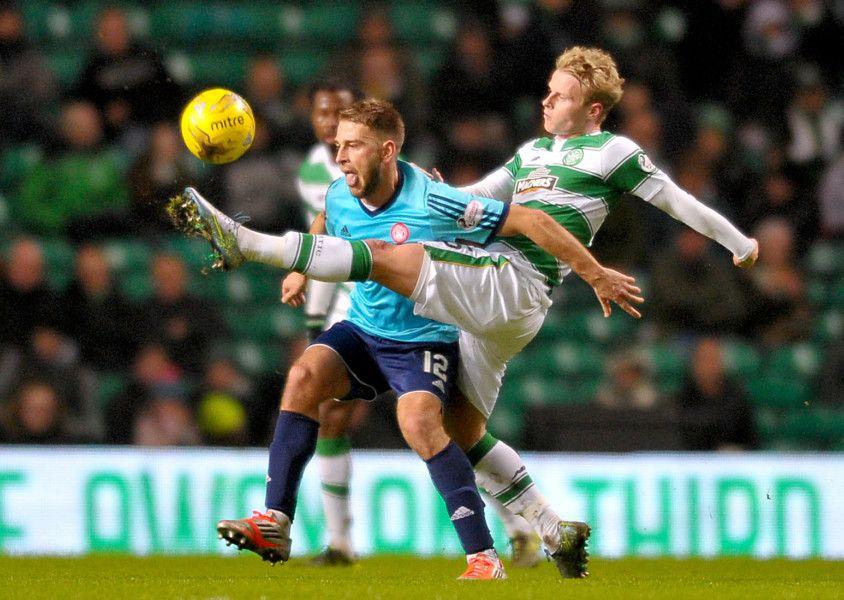 Gramoz (số 12) thời còn chơi ở Scotland trong màu áo Hamilton. Ảnh: PA