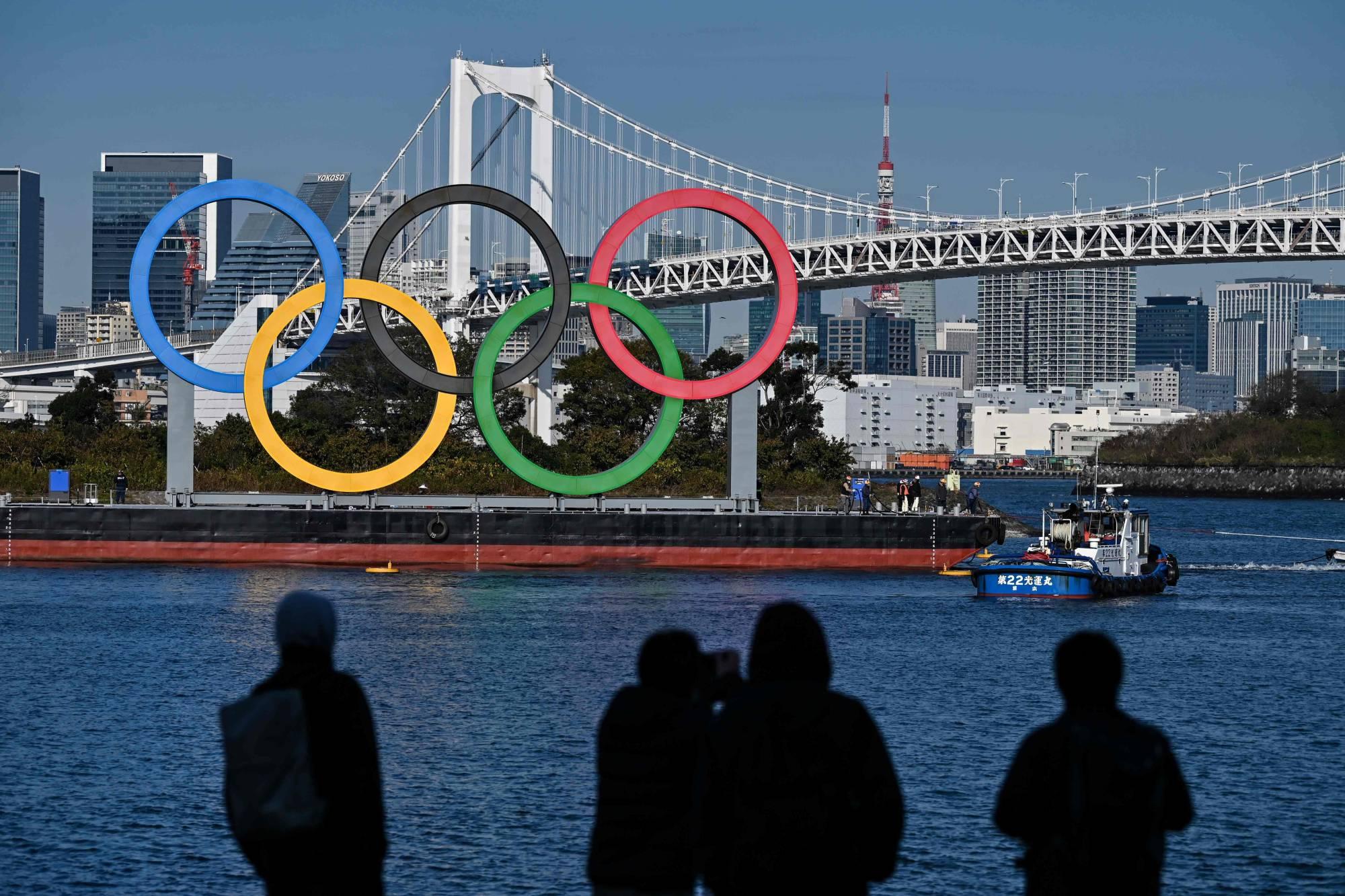 Jepang masih bertekad menjadi tuan rumah Olimpiade pada musim panas 2021. Foto: AFP