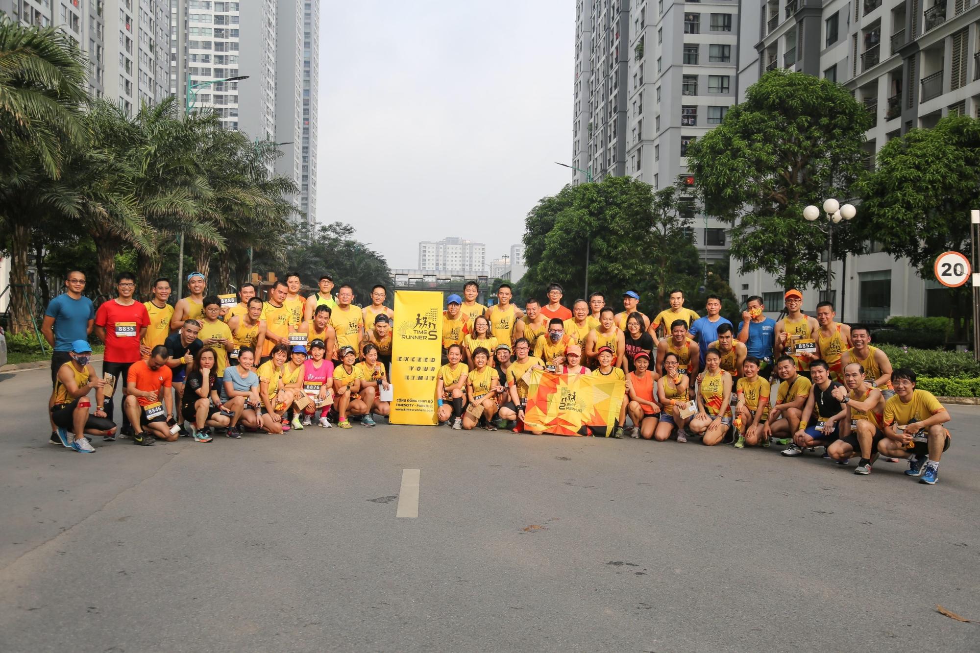 Times Runners running team member in uniform yellow shirt.