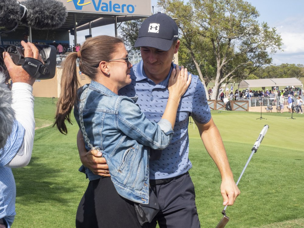 Spieth shared his joy with his wife Annie Verret after being crowned at the Texas Open on April 4.  Photo: AP