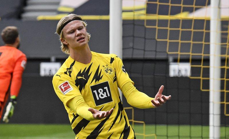 Haaland chơi ổn định nhưng Dortmund đang kém top 4 Bundesliga bảy điểm. Ảnh: AP.