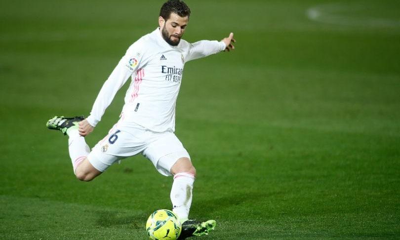 Nacho sẽ đá thay Ramos ở trận tứ kết lượt đi gặp Liverpool. Ảnh: PA.