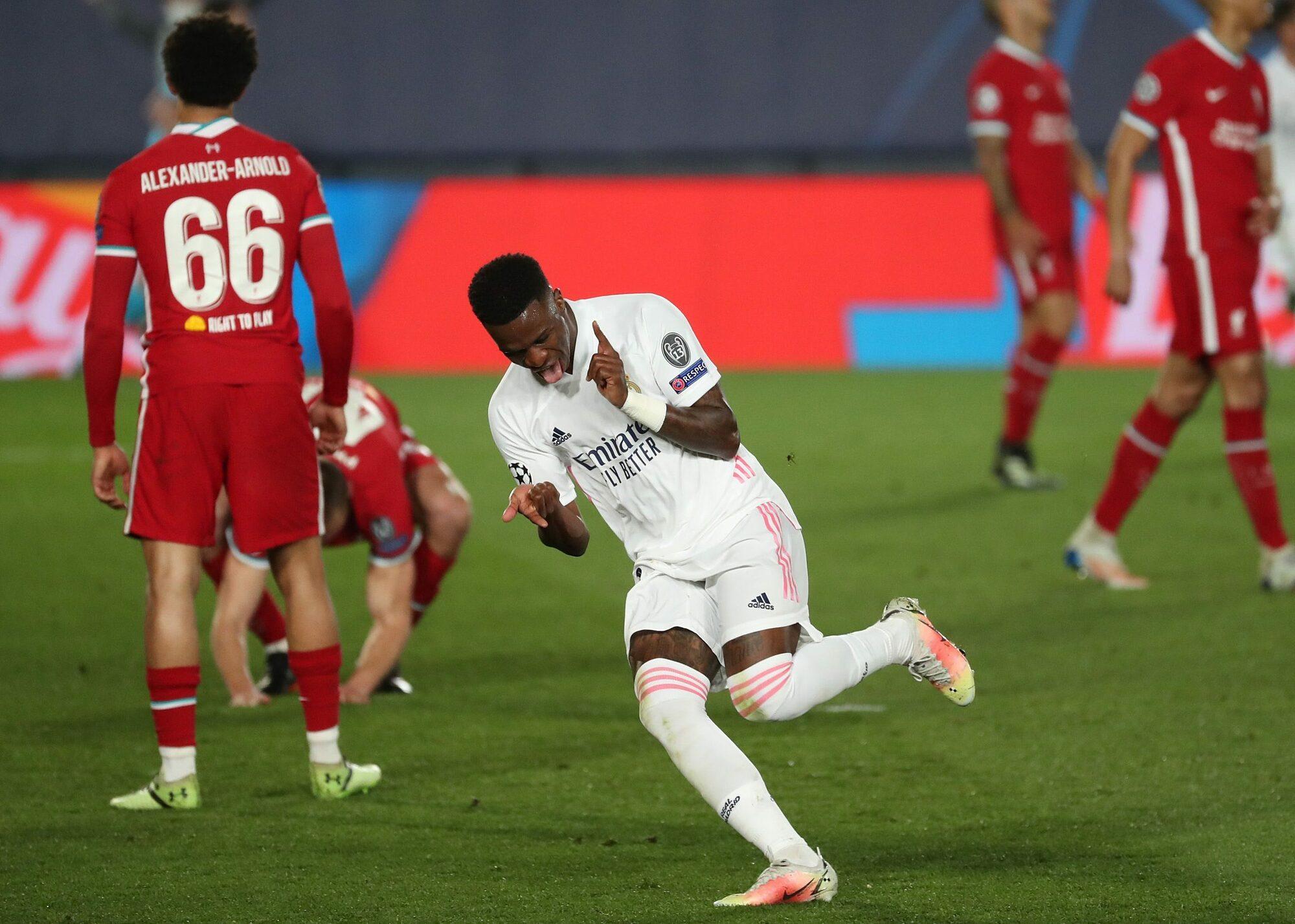Vinicius mừng bàn nâng tỷ số lên 3-1 cho Real trong trận thắng Liverpool 3-1 hôm 7/4. Ảnh: EFE