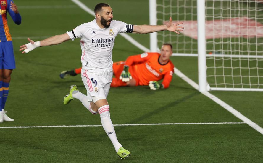 Benzema menempatkan Real di atas Barca.  Foto: EFE.