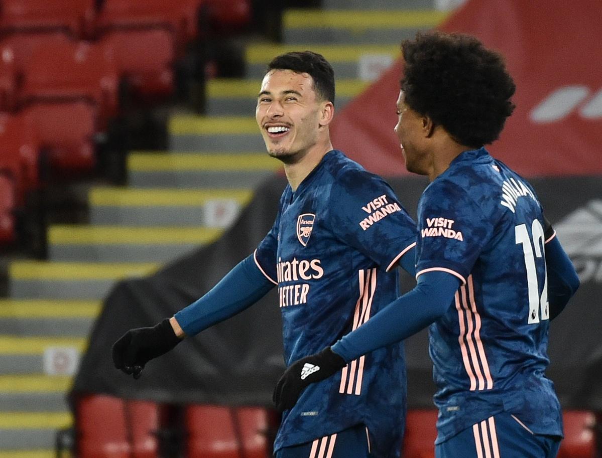 Martinelli merayakan gol dengan Willian.  Foto: Reuters.