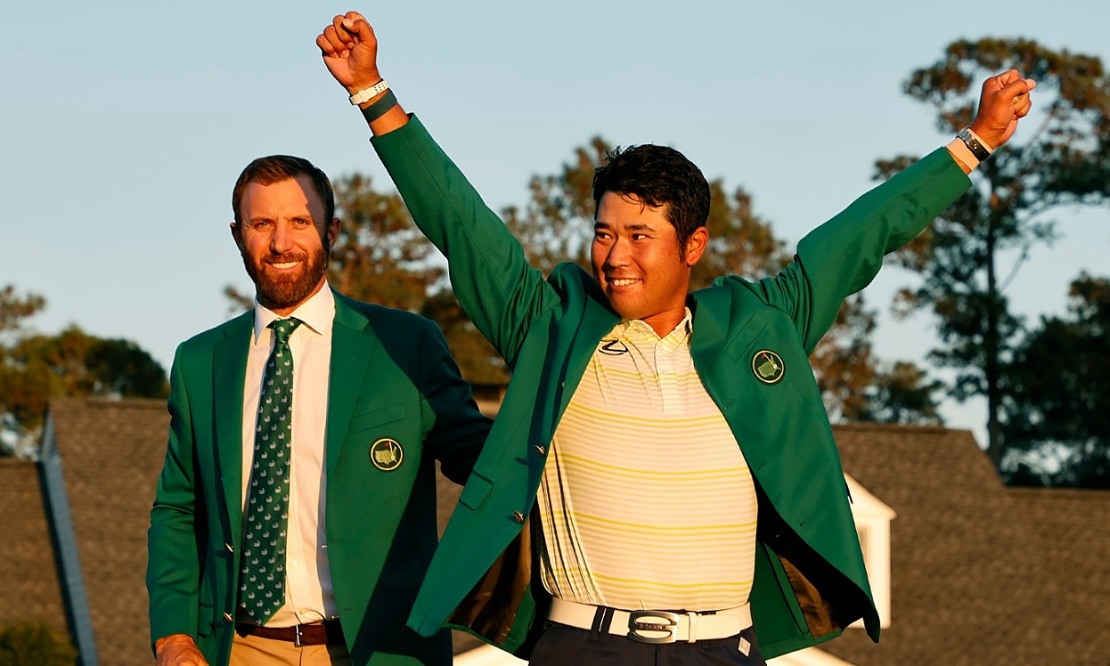 Johnson (left) had to stay for two days to wait for the Green Jacket to be handed over to champion Matsuyama.  Photo: The Masters