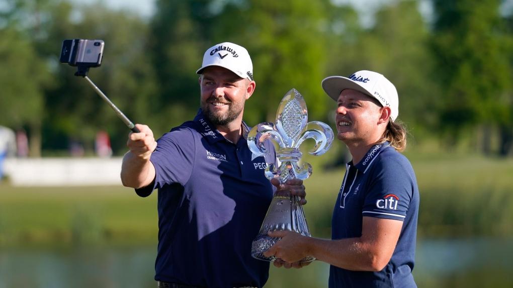 Leishmann (left) and Smith celebrate the PGA Tour championship at TPC Louisiana on April 25.  Photo: AP
