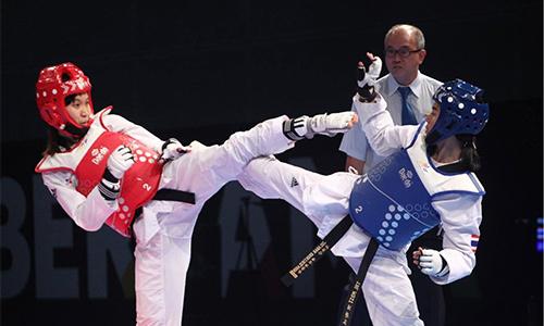 Kim Tuyền (giáp đỏ) giúp Taekwondo Việt Nam trở lại Olympic sau năm 2016 vắng bóng. Ảnh: Ngọc Hải