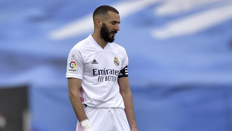 Gol telat Benzema tidak dapat membantu Real membalikkan keadaan dalam perlombaan kejuaraan.  Foto: AFP.