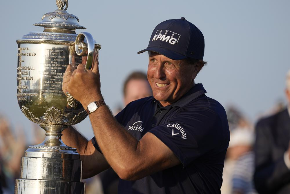 Mickelson lifts the Wanamaker trophy after winning the PGA Championship at Ocean Stadium on May 25.  Photo: AP