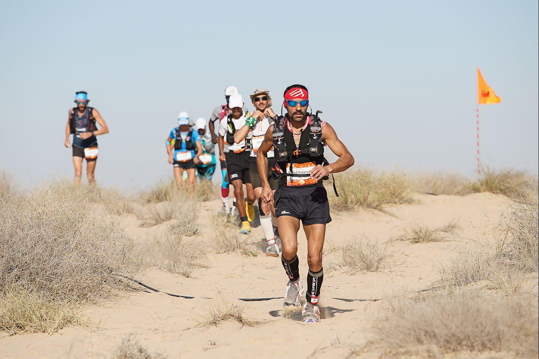 The terrain of ultra marathon running is very diverse, from flat roads, hills to deserts.  Photo: Al Marmoom Ultramarathon.