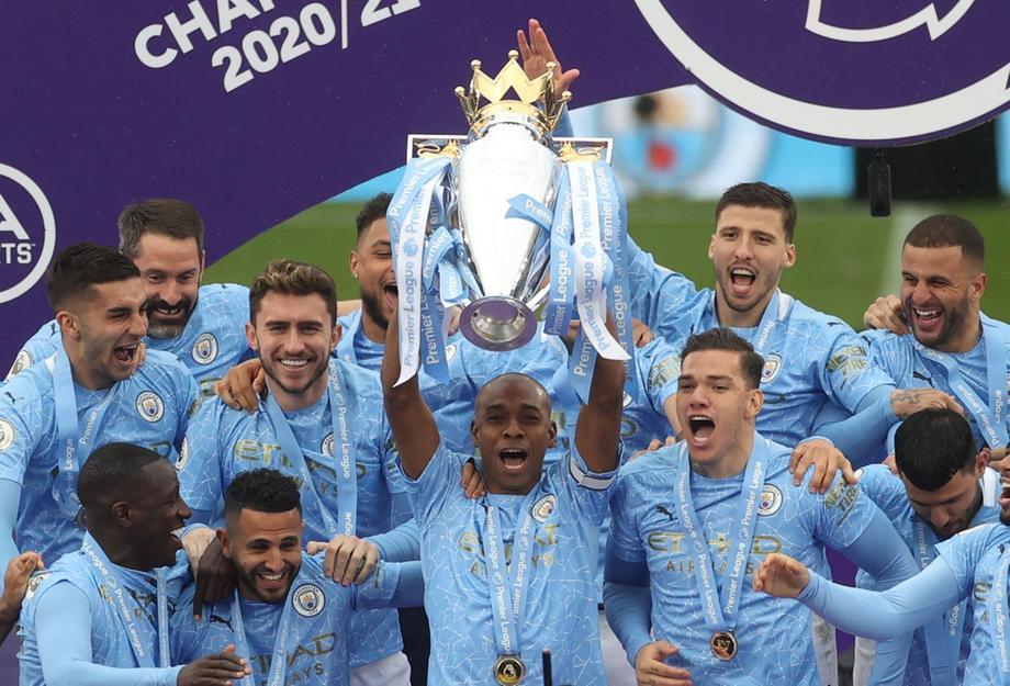 Ruben Dias dan rekan satu timnya mengangkat gelar Liga Premier.  Foto: Reuters.