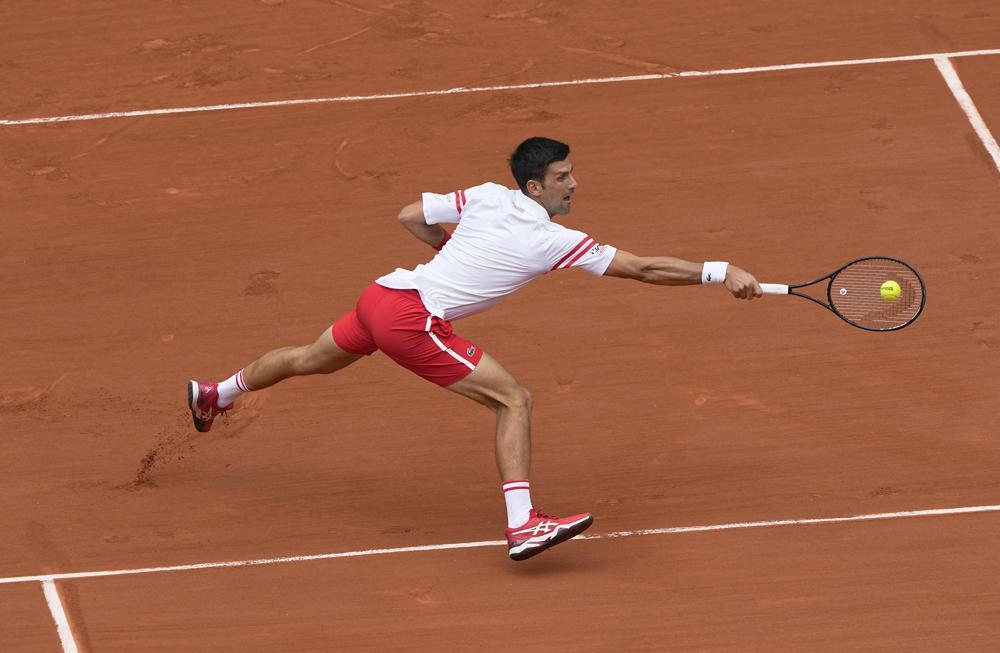 Djokovic lần đầu thắng sau khi thua set một và set hai tại Roland Garros. Ảnh: AP