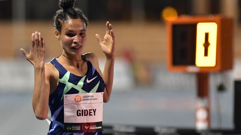 Gidey celebrates after finishing first.  CNBC photo.