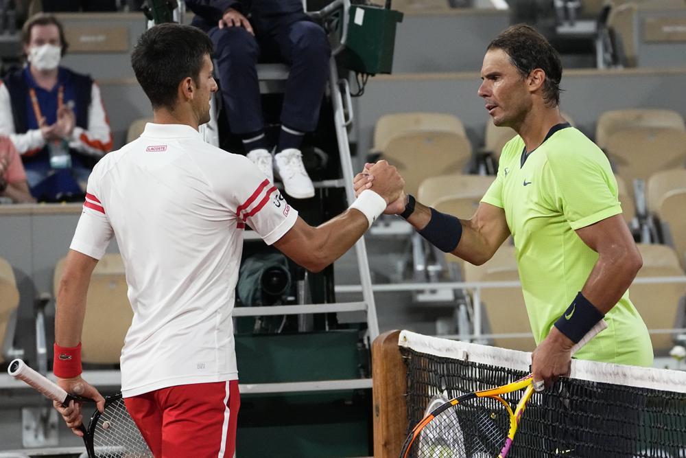 Nadal (phải) thua trận thứ ba trong 108 trận đã đấu tại Roland Garros. Ảnh: AP
