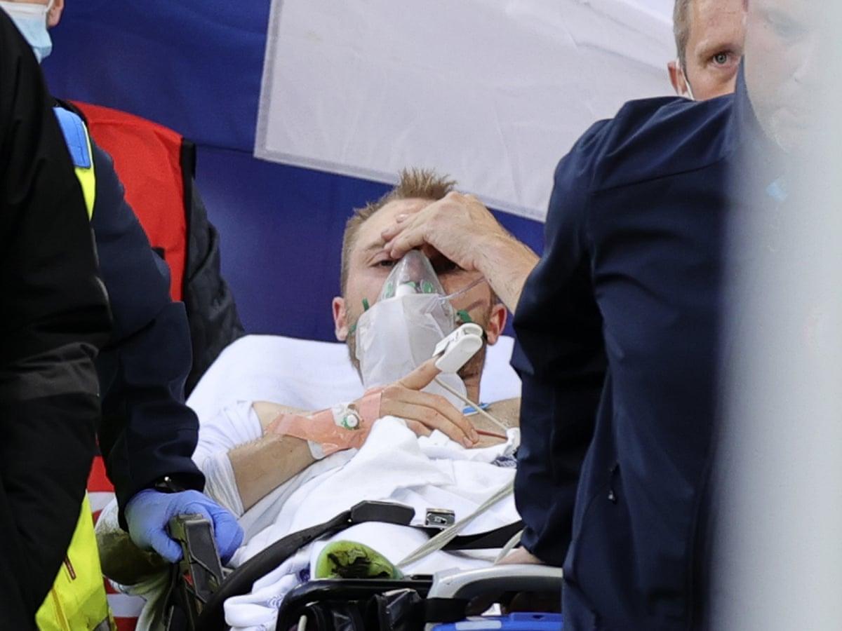 Eriksen tỉnh táo ngay sau khi được sơ cứu trên sân Parken hôm 12/6. Ảnh: Reuters