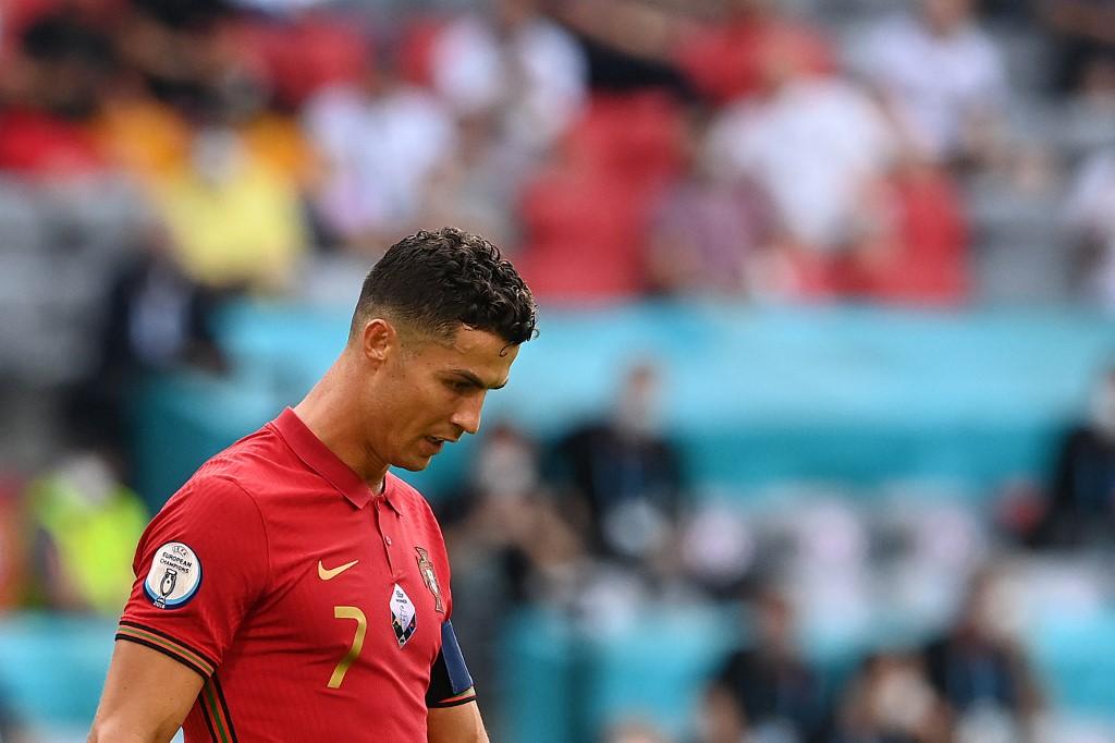 Ronaldo thật vọng rời sân sau trận thua Đức. Ảnh: AFP.
