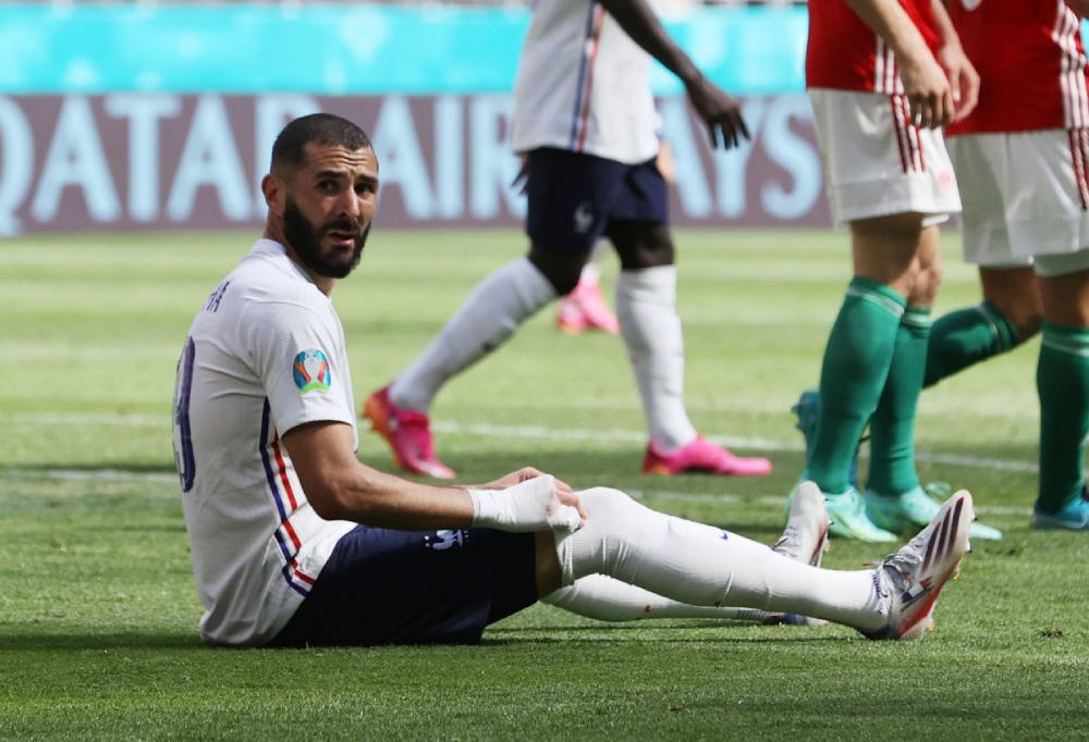 Benzema chưa lấy lại sự tự tin và cảm giác sau khi tái xuất với đội tuyển. Ảnh: Reuters.