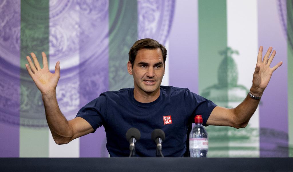 Federer chỉ hơn Djokovic một danh hiệu Grand Slam. Ảnh: Wimbledon