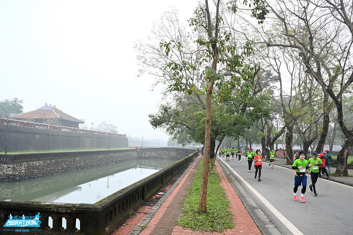The road runs through Hue Citadel.