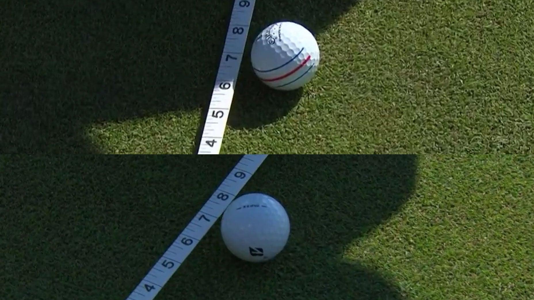 Penyelenggara menggunakan pita pengukur untuk menentukan hasil dalam kompetisi tee di dekat gawang pada 6 Juli.  Foto: Golf.com