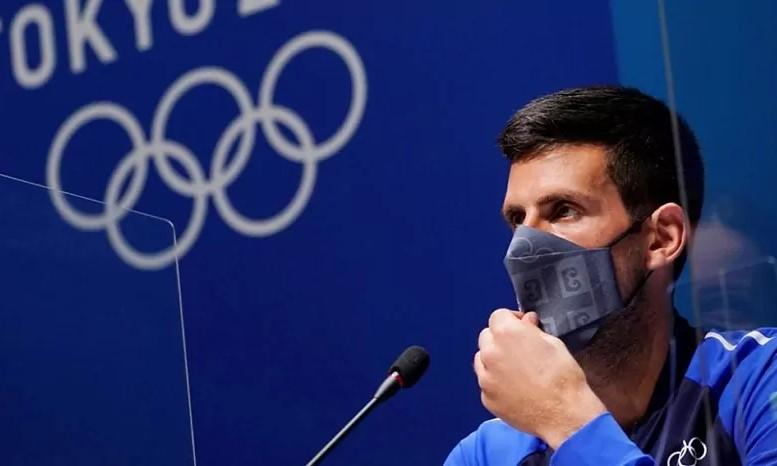 Djokovic trả lời họp báo trước khi tranh tài tại Olympic 2021. Ảnh: EFE.
