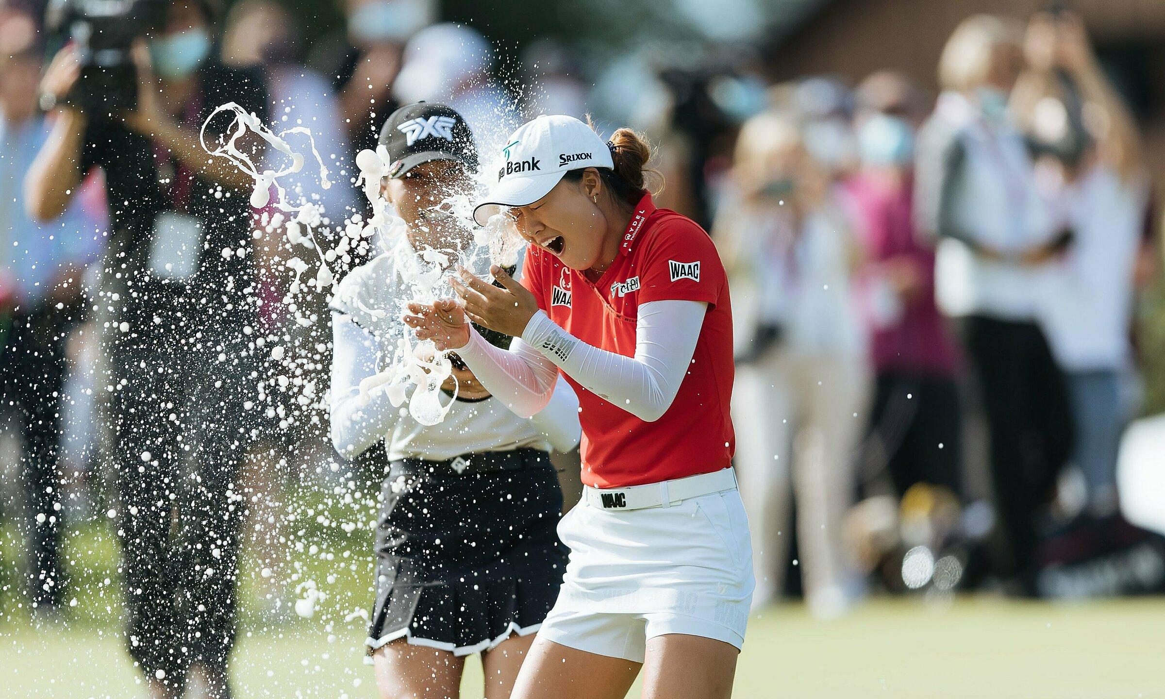 Lydia Ko sprayed champagne to congratulate Minjae Lee.  Photo: Evian Championship