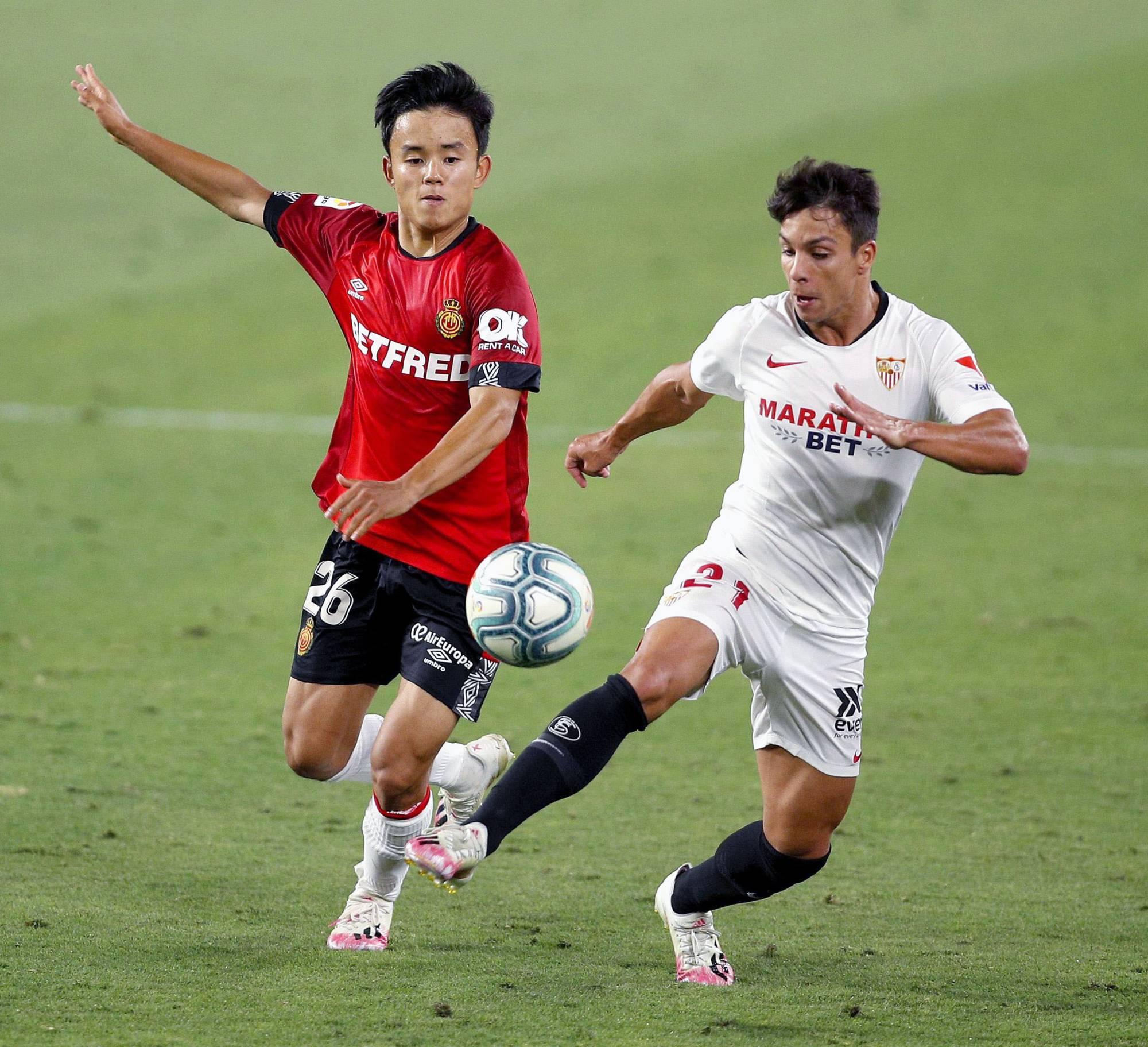"Kubo (ซ้าย) ต้องเดินผ่านอีกสามทีมในช่วงสองปีที่ผ่านมา เพราะเขาไม่สามารถหาที่อยู่ที่ Real ได้  ภาพถ่าย: ""Kyodo"""