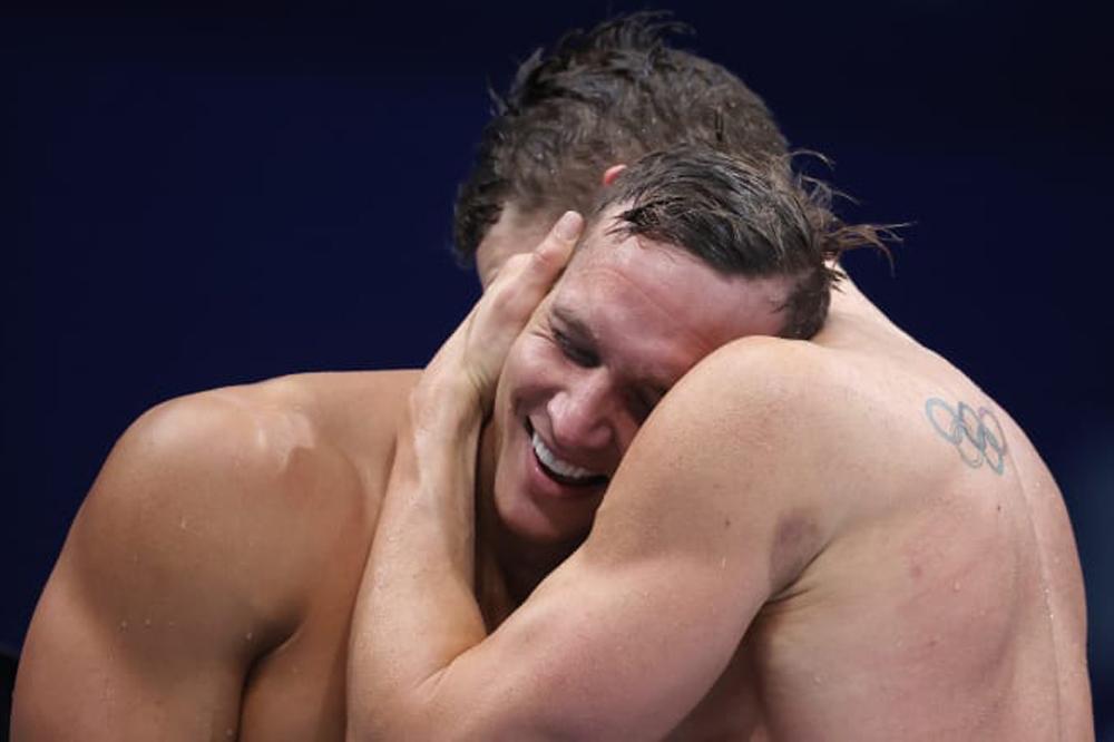 Các nam VĐV Mỹ xuống nước ở Olympic là có vàng nội dung 4x100m tiếp sức hỗn hợp. Ảnh: AFP