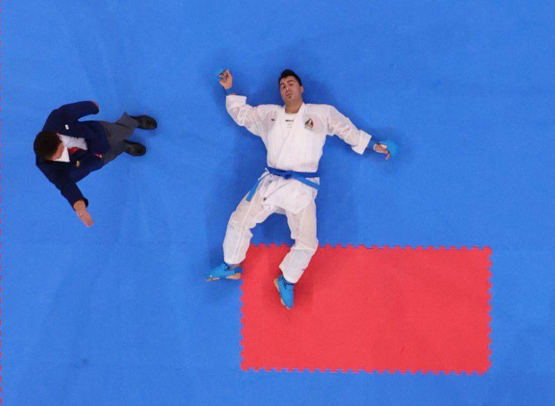 Ganjzadeh giành HC vàng trong trạng thái bất tỉnh. Ảnh: Reuters