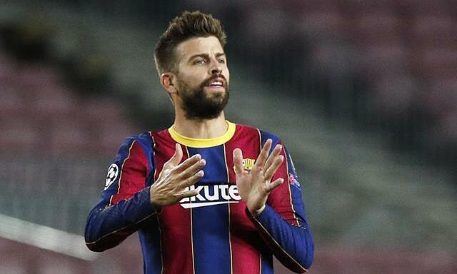 Pique đồng ý chơi với mức lương tượng trưng, để các tân binh Barca có thể thi đấu ở La Liga. Ảnh: Reuters