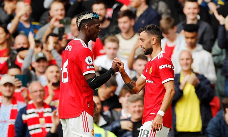 Pogba ฉลองการเปิดการให้คะแนนกับ Fernandes  ภาพ: Reuters