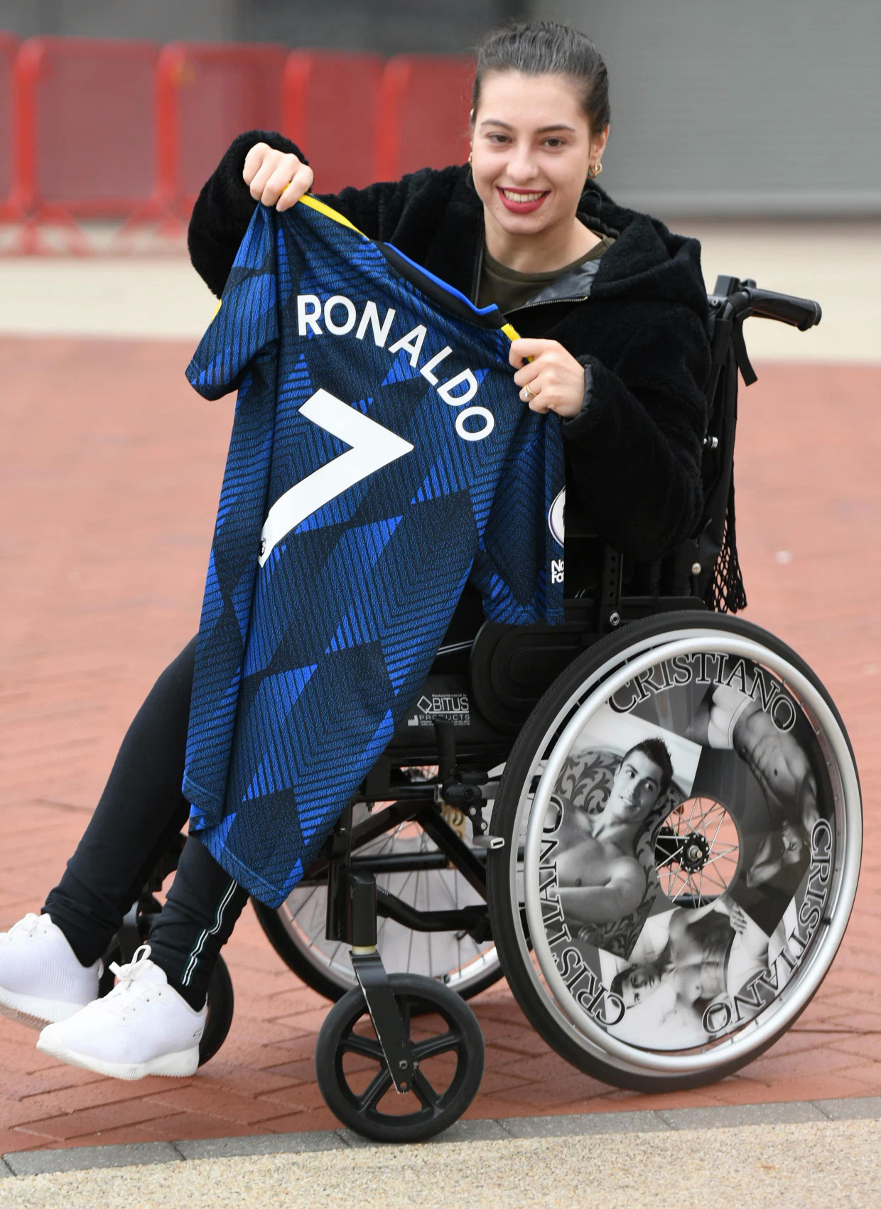 A Ronaldo fan rejoices with the idol's number 7 shirt bought at Old Trafford on September 4.