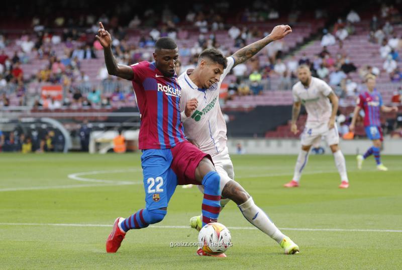 Emerson (trái) đã chơi ba trận cho Barca, trước khi bị đẩy sang Tottenham. Ảnh: Reuters