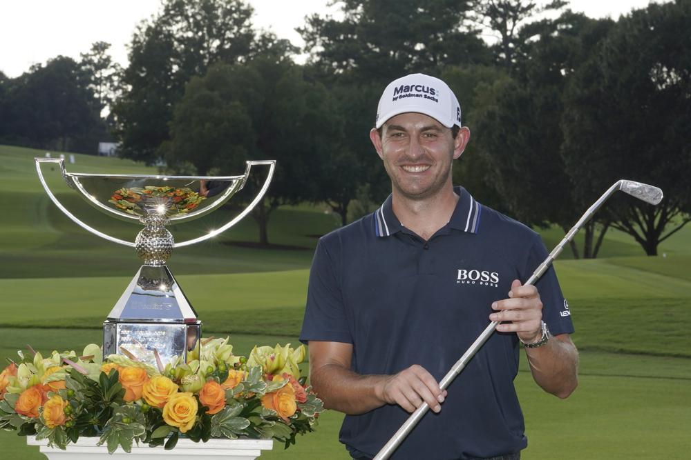 Cantlay mừng chức vô địch Tour Championship và FedEx Cup trên sân East Lake, Atlanta hôm 5/9. Ảnh: AP