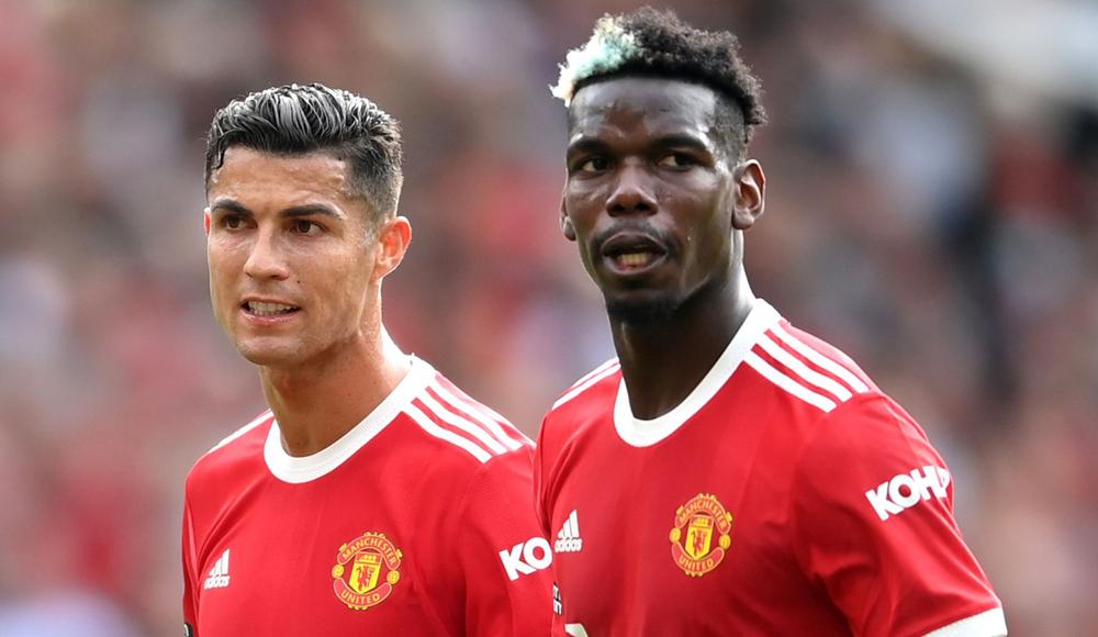 Ban lãnh đạo Man Utd kỳ vọng sự có mặt của Critiano Ronaldo sẽ khiến Paul Pogba hào hứng hơn với việc ở lại Old Trafford. Ảnh: AFP